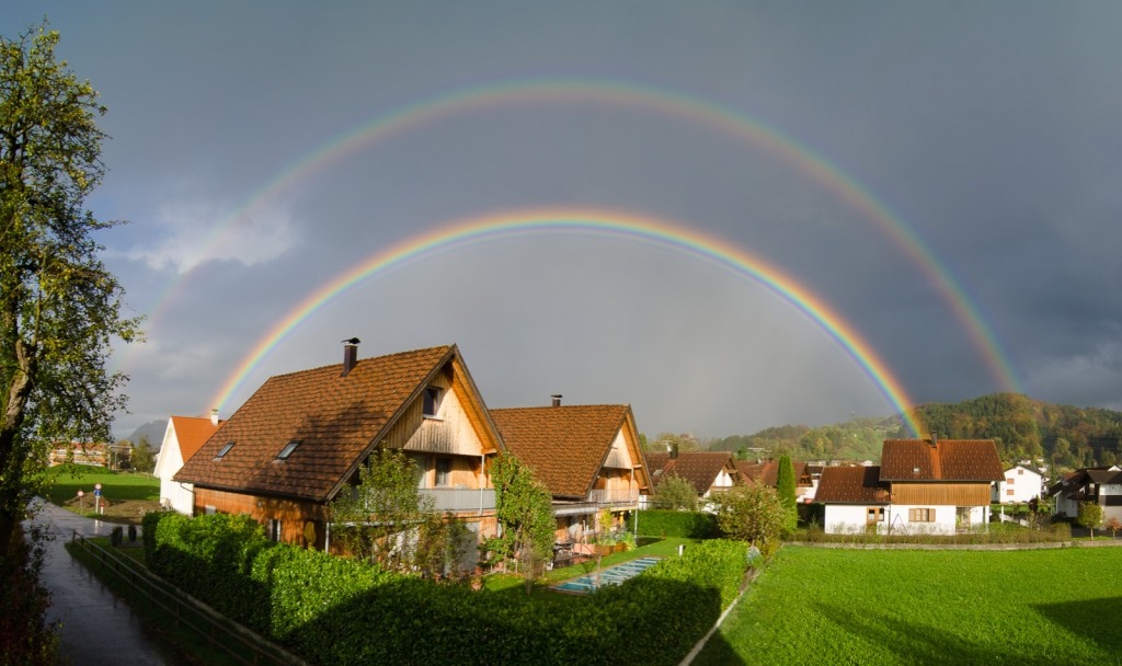 Panoramic image of a very bright double rainbow.