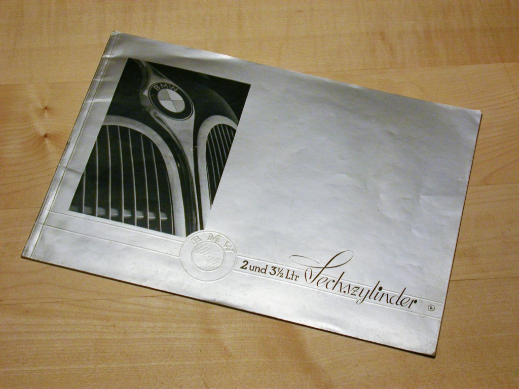 The cover is silver in color, the BMW logo is embossed.
