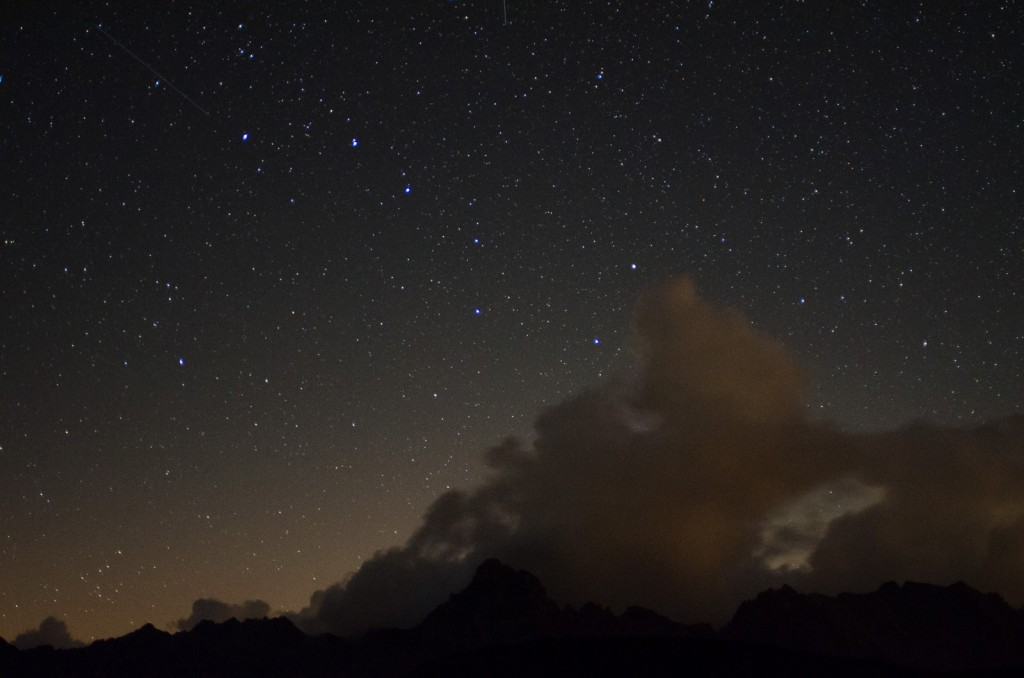 Clouds are come in from the West below the Big Dipper asterism in the Ursa Major constellation.